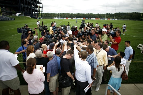 Patriots quarterback Tom Brady is swarmed by media following the morning workout on Day 1 of training camp.
