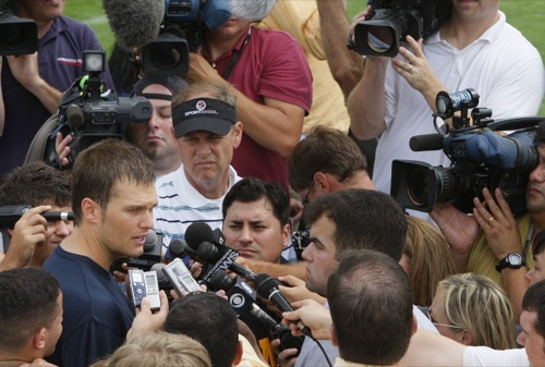 New England Patriots starting quarterback Tom Brady speaks to the media after the team's first session at training camp.