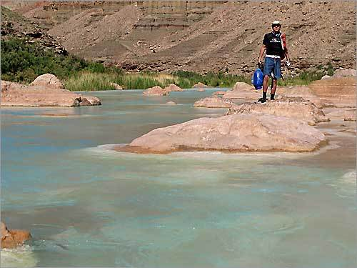 Zachary Johnson on the hike up the Little Colorado to the swimming spot. The little Colorado is turquoise blue because of the mineral deposits on the rocks below the surface.