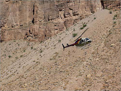 A helicopter flies out of the end of the canyon at the Indian Reservation - technically Lake Mead at this point.