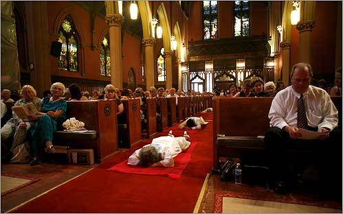 In the process of their ordination, Gloria Ray Carpeneto of Maryland, Judith A.B. Lee of Florida, Gabriella Velardi Ward of New York, and Mary Ann McCarthy Schoettly lay down in the aisle of the Church of the Covenant in Boston. The ceremony was not recognized by the Vatican.