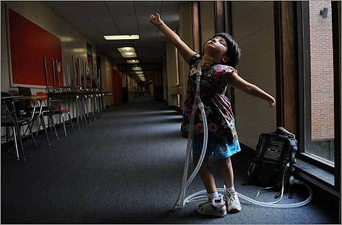 Six-year-old Jessica Leahey, who uses a respirator hooked up through a tracheotomy, showed off her ballet moves while at summer camp at the Day Middle School in Newton. She has Moebius syndrome, a rare neurological disorder that causes facial paralysis and difficulty swallowing or breathing.