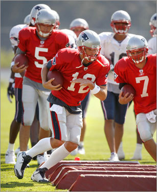 Tom Brady (12) runs a drill with fellow quarterbacks Kevin O'Connell (5) and Matt Gutierrez (7) on Saturday.