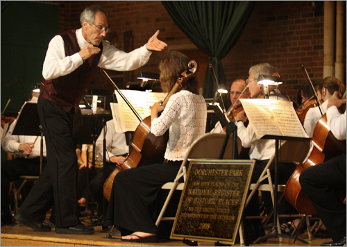 July 27 in Dorchester Hundreds of guests attended a performance by the Boston Landmarks Orchestra with Conductor Charles Ansbacher (left). The event was scheduled for Dorchester Park and was moved to the Auditorium of St. Gregory's School in Dorchester, due to the rain storm.