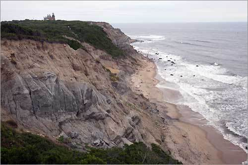 The 150-foot-tall Mohegan Bluffs on Block Island, with Southeast Light in the background.