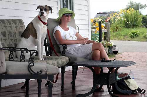 Shavon Martin enjoys a glass of wine with her dog Sadie alongside at the Spring House Hotel on Block Island.