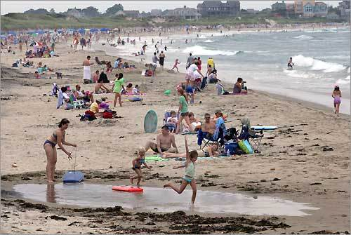 People enjoy the sun and water at Crescent Beach, the largest beach on Block Island and the closest to the ferry landing.