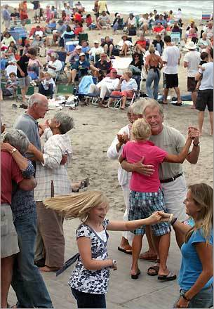 Block Islanders dance to the blues performed by Johnny Nicholas and the All Stars during a free concert at the town beach.
