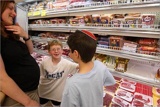 Rinath Jeselsohn of Newton shopped at the Butcherie, a kosher supermarket in Brookline, with her two sons, Eitan (right), 9, and Elad, 8.