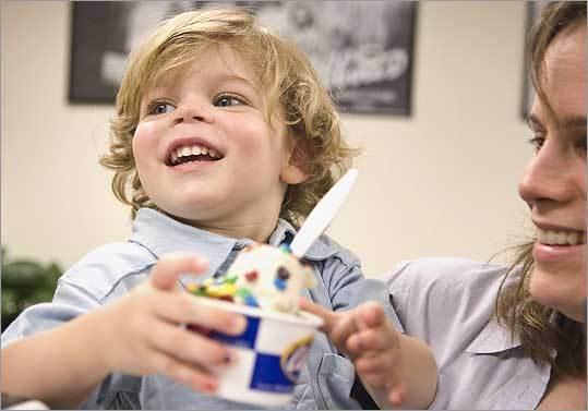 Lane Kierstead, with mom Jana, gets a cup of Abbott's Frozen Custard.