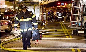 More than 100 firefighters responded to a fire at a West Roxbury restaurant Aug. 29, 2007. A 3-ton air-conditioning unit partially crashed through the roof.