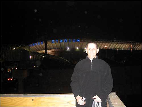 James Burke, from Boston, poses in front of Yankee Stadium one night this past spring after Manny Ramirez hit two homers off Mike Mussina and the Sox won in the Bronx.