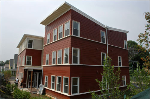 The Hyde-Blakemore Condominiums in Roslindale, developed for lower income families, have many modern details, including the flying-V roofline that channels rain to a garden below.