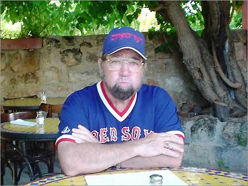 Joel Saren, of Hampstead, N.H., sports a hat that says 'Red Sox' in Hebrew, while touring Israel.