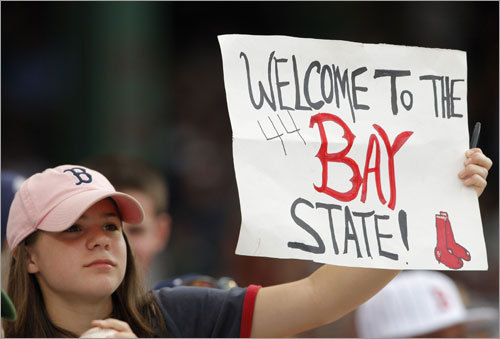 A fan greets Red Sox newcomer Jason Bay to Fenway Park.