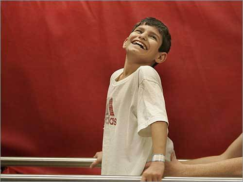 In January 2005, Rakan Hassan, 12, was shot and paralyzed, and his parents were killed when their car was riddled with gunfire by a US Army patrol in Iraq. Rakan was brought to Boston through the efforts of humanitarians determined that he receive medical care. Now, with the news that Rakan was killed by a bomb planted at his home in Mosul, Rakan's time in Boston seems more precious, more fleeting, more tragic for what could have been.