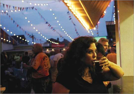 Susan Amaral of New Bedford sipped sangria opening night at the weekend-long Feast of the Blessed Sacrament festival.