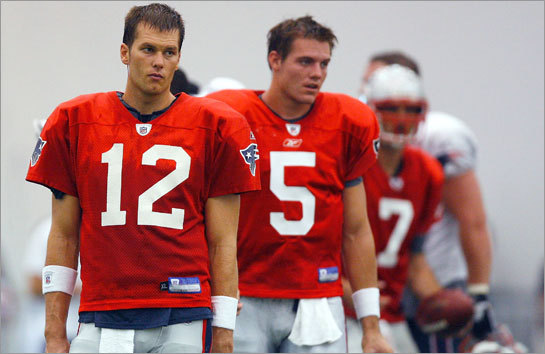 Quarterbacks Tom Brady (12), Kevin O'Connell (5) and Matt Gutierrez (7) participate in drills during training camp.