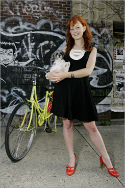 """Morgan First , 24, Kenmore Profession: MAP Boston guidebook entrepreneur Style: Fun and flirty: denim halter dress, brown leather belt, flat boots. Bike model: Yellow-green Dutch Gazelle JollyBike with hand-painted flowers. How long have you been riding around Boston? Two and a half years. Where she rides: To brunch in the South End or at the Other Side Café, to sell her guidebook at the South End Open Market. Any places in the city you avoid while on a bike? 'Lots,' First says simply. She rides through parks or along the Esplanade whenever possible. Secrets to biking in a dress? She's been known to hold down her skirt with one hand. How to stay clean? Fenders, an enclosed chain, and a coat guard. """"I've never gotten messy,"""" she says. Must-have accessories? A built-in lock. She's waiting for a blue coat guard and wants """"a fun-looking bell."""""""
