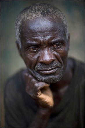 Farmer Livrais Bernard, 54, poses for a photo in his home in Decouez, Haiti, Friday, July 11, 2008.