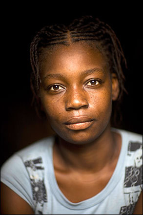 Student Natalie Ipolite, 20, poses for a photo in her home in Camatei, Haiti, Friday, July 11, 2008.