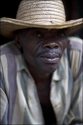Farmer Cecon Michel, 53, poses for a photo at his home in Decouez, Haiti, Friday, July 11, 2008.