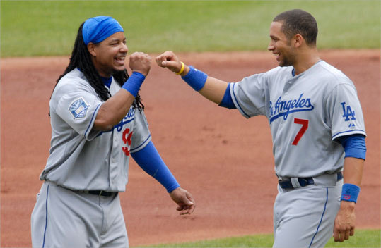 Manny Ramirez (left) greets teammate James Loney after the end of the first inning during the Dodgers game against the Cardinals on Thursday, Aug. 7, 2008, in St. Louis.