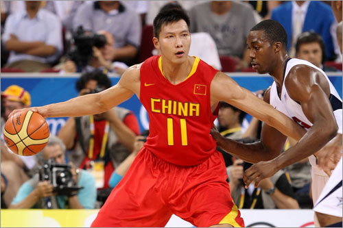 NBA player and China star Yi Jianlian posted up on Dwight Howard.