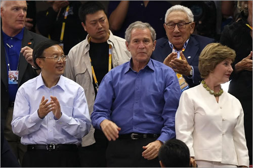 (Left to right): Foreign Minister of the People's Republic of China Yang Jiechi, US President George W. Bush, former secretary of state Henry Kissinger and First Lady Laura Bush attended the game.