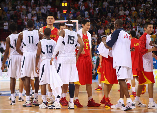 China stayed close in the first half, but the US pulled away to an easy victory in the second. Here, the teams shook hands after the game.