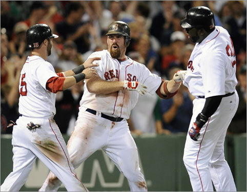 A wild night at Fenway With an eighth-inning, three-run shot over the wall in left, Kevin Youkilis finally put the Red Sox on top for good in a wild game in which the Red Sox and Rangers combined for 36 runs, 37 hits, and 4 errors. Here's a look at some of the highlights ...