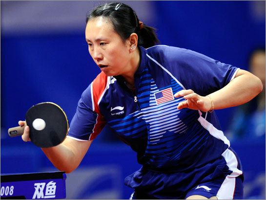Gao Jun of the US returns a shot during the World Team Table Tennis Championship.