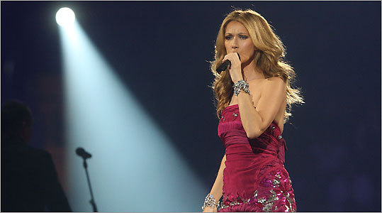 The setting at the Banknorth Garden was packed with pageantry, but Celine Dion's voice seared through the theatrics.