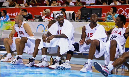 The US team relaxes on the sidelines as the clock winds down. They will face world champion Spain on Saturday in a matchup of unbeatens. The winner will earn the Group B's top seed for the quarterfinals.