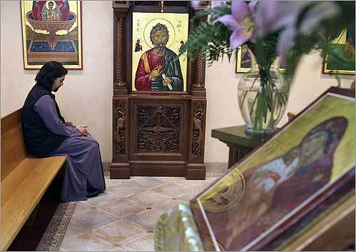 The pastor of the Transfiguration Greek Orthodox Church in Lowell, Rev. Fr. Demetrios T. Costarakis, sat in his church, from which a silver box, containing a 2,000-year-old relic of St. Andrew, was stolen. The box once sat on the ledge in front of the icon.