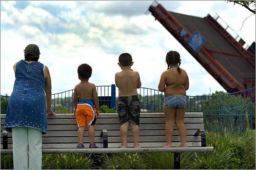 The raising of the Neponset Bridge over the Neponset River drew the attention of Janice Clark Fitzgerald (left), of Dorchester, and her grandchildren, Jordon Allen, 3, of Quincy, Tyler Davis, 3, of Holbrook, and his sister Holly, 5.