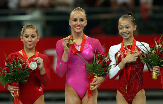 (Left to right): Silver medalist Shawn Johnson of the United States, gold medalist Nastia Liukin of the United States, and bronze medalist Yang Yilin of China pose together after the women's individual all-around artistic gymnastics final.