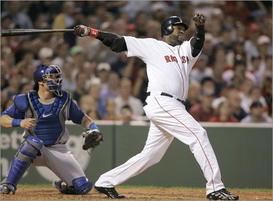 Boston Red Sox's David Ortiz, right, follows through on a three-run home run off Texas Rangers' Tommy Hunter as Rangers catcher Jarrod Saltalamacchia watches.