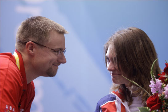 Czech Republic's Katerina Emmons shares a moment with her husband Matt Emmons of the US after striking gold in Beijing.