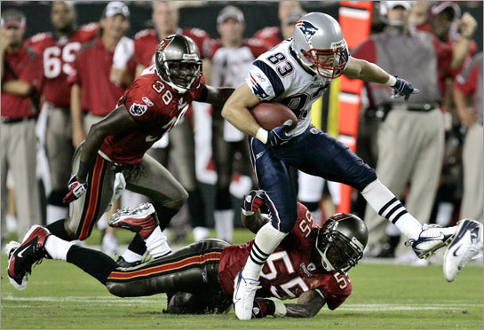 New England Patriot's wide receiver Wes Welker (83) gets away from Tampa Bay Buccaneers' defenders Derrick Brooks (55) and Eugene Wilson (38).