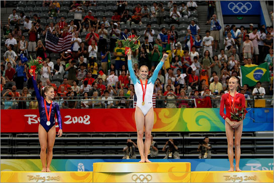 Shawn Johnson (left) of the United States poses with the silver medal, Sandra Izbasa of Romania poses with the gold medal and Nastia Liukin of the United States poses with the bronze medal after the women's individual floor final.