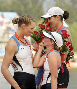 US coxswain Mary Whipple kisses her medals as Caroline Lind, left, looks on after they won the gold medal in the women's eight final.