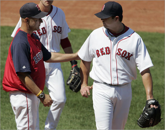 Josh Beckett likely didn't want to hear Terry Francona's words of encouragement after the Sox starter was pulled from the game.