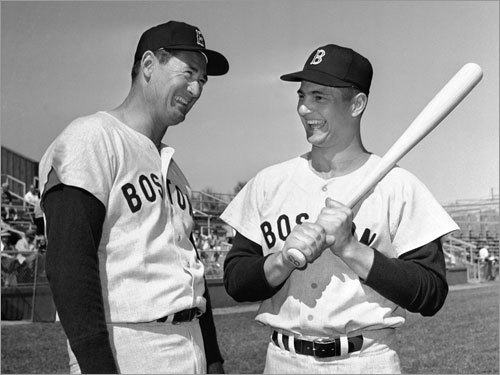The native of Southampton, N.Y. took over for the legendary Ted Williams (left) as Red Sox left fielder in 1961. With his unique batting stance -- he held his bat high and vertical -- 'Yaz' won the AL batting title in 1963. He would play 22 seasons in the major leagues, all with the Red Sox.