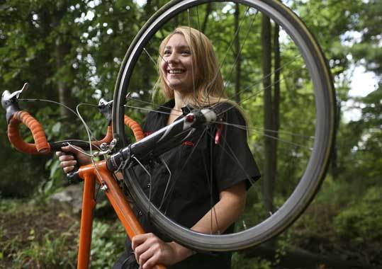 Jocelyn Gaudi, who works part time at Cycle Loft in Burlington, uses her bike to commute 20 miles each day from her home in Medford to her job at the bicycle shop, as well as to a second job in Woburn.