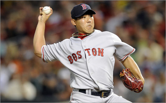 Daisuke Matsuzaka of the Boston Red Sox pitches against the Baltimore Orioles.