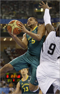 With Wade defending him, Australia's Patrick Mills wasn't able to get much on this play, but he did lead the Aussies with 20 points and 3 steals.