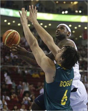 LeBron James (16 points) gets to the basket despite pressure from Australia's Andrew Bogut.