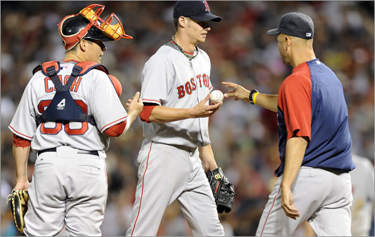 Clay Buchholz (61) is taken out of the game by manager Terry Francona (right) in the third inning.