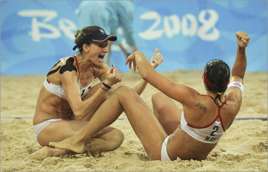 Kerri Walsh, left, and Misty May-Treanor of the U.S., celebrate their gold medal win in the women's beach volleyball match against China.